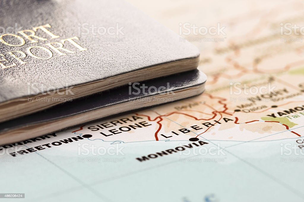 Destination Liberia. Two passports on the map. Travel concept. stock photo