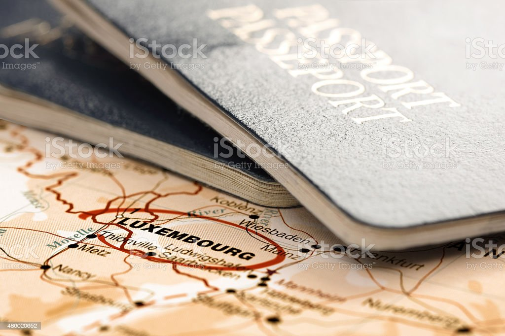 Destination Luxembourg. Passports on the map. Travel concept. stock photo