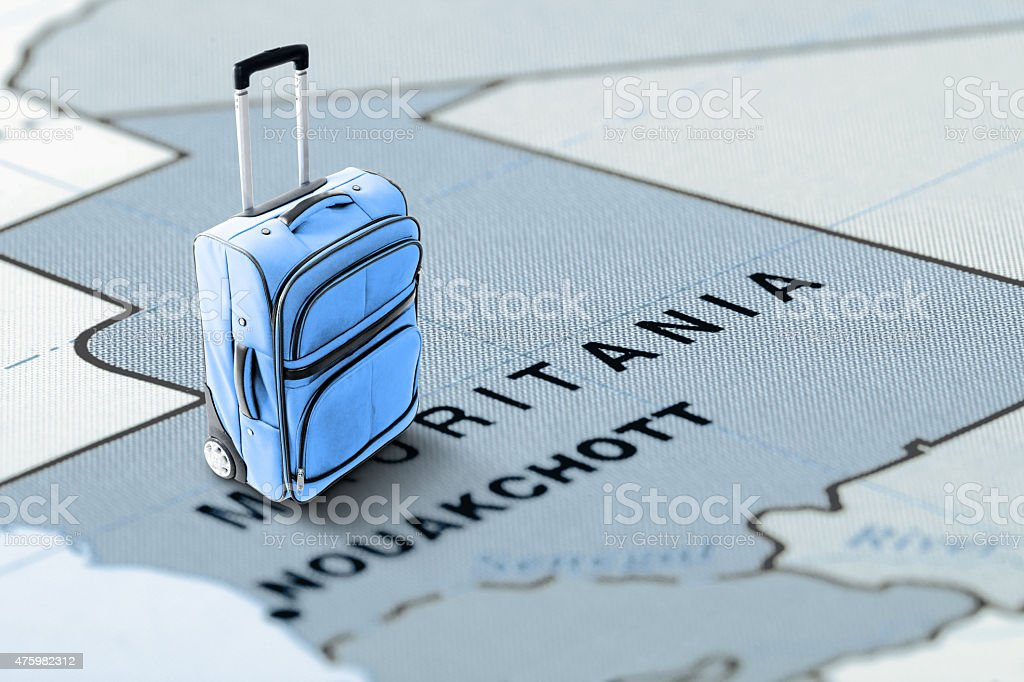 Destination Mauritania. Blue suitcase on the map. stock photo