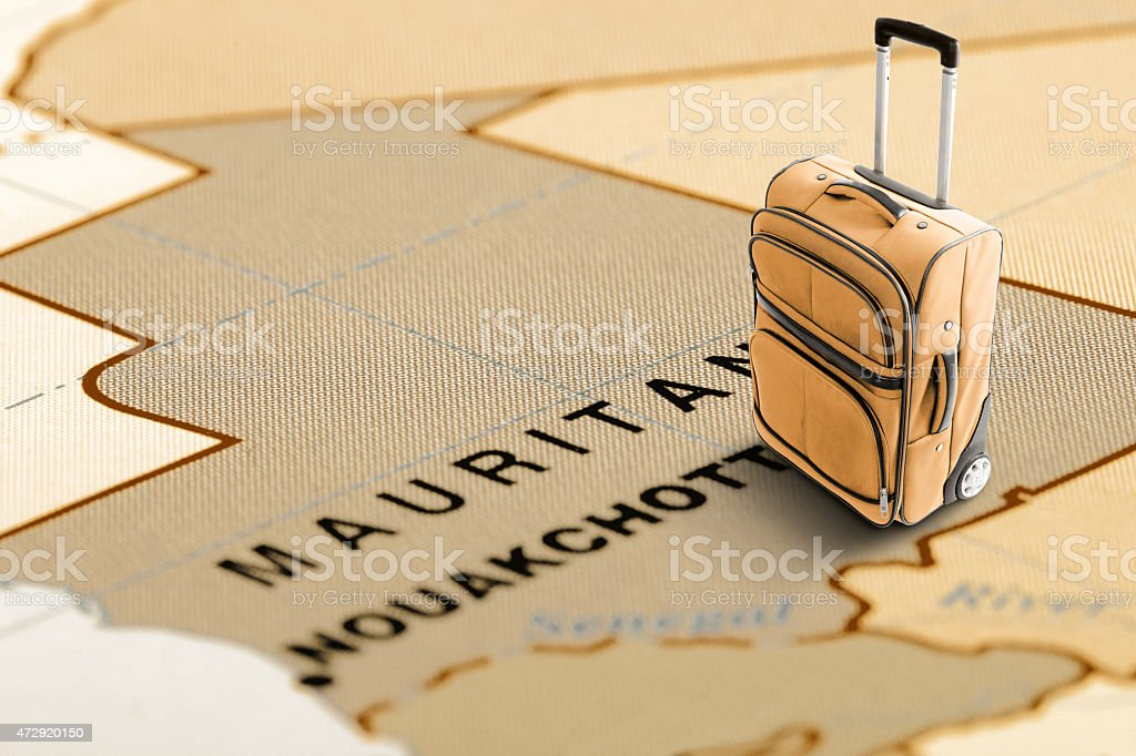 Destination Mauritania. Orange suitcase on the map. stock photo