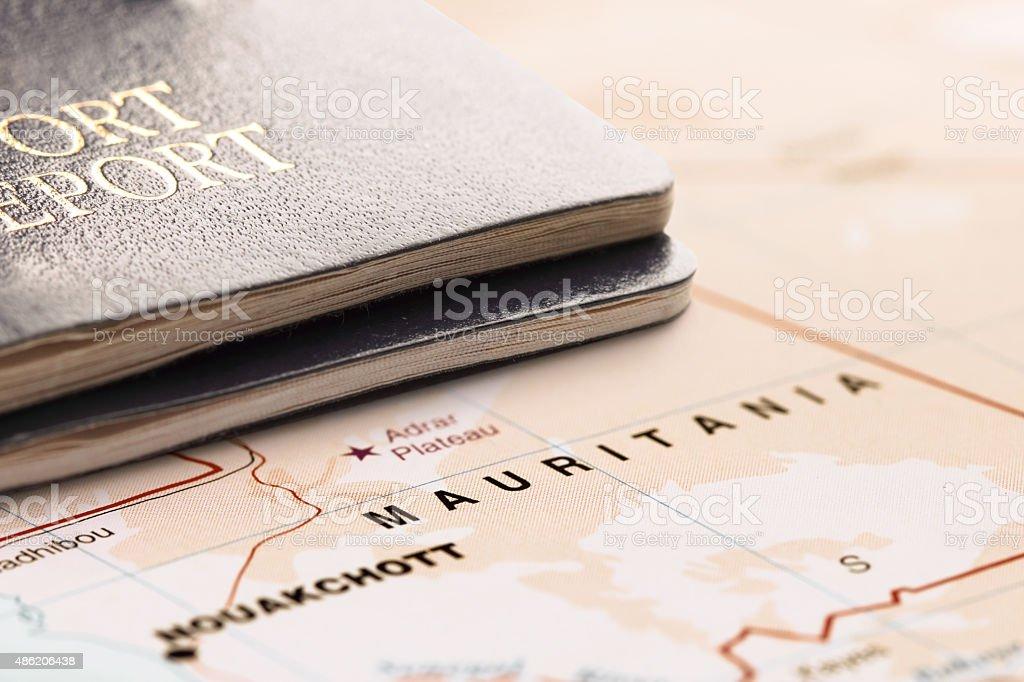 Destination Mauritania. Two passports on the map. Travel concept. stock photo