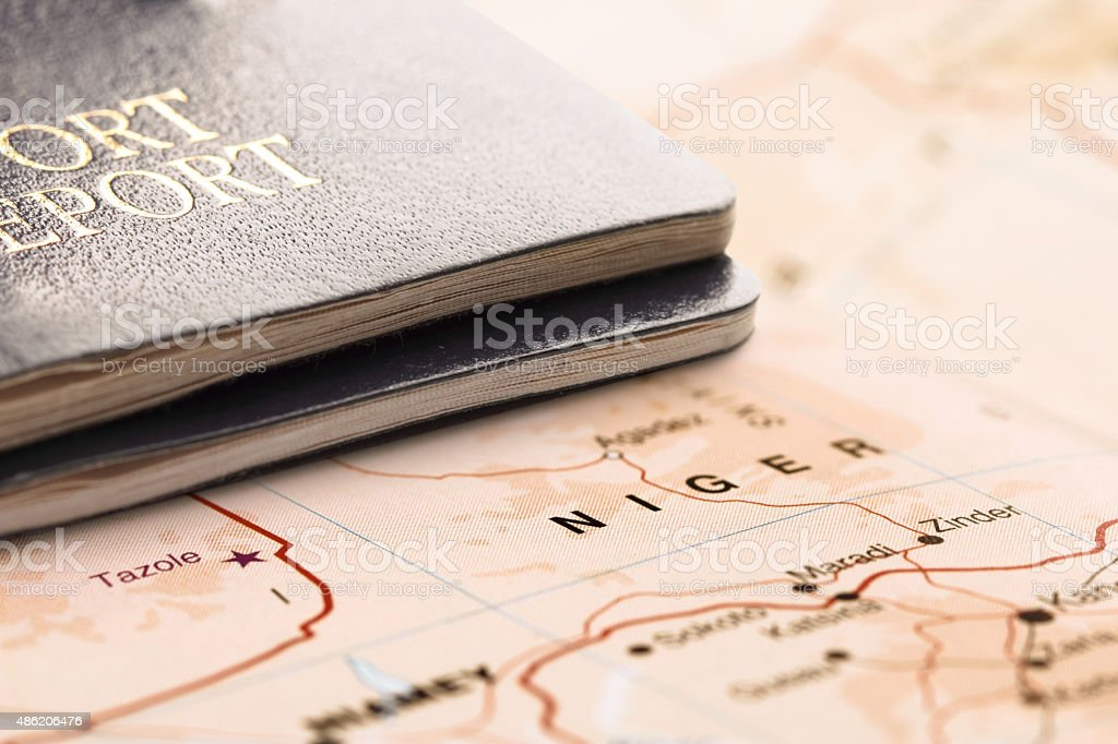Destination Niger. Two passports on the map. Travel concept. stock photo