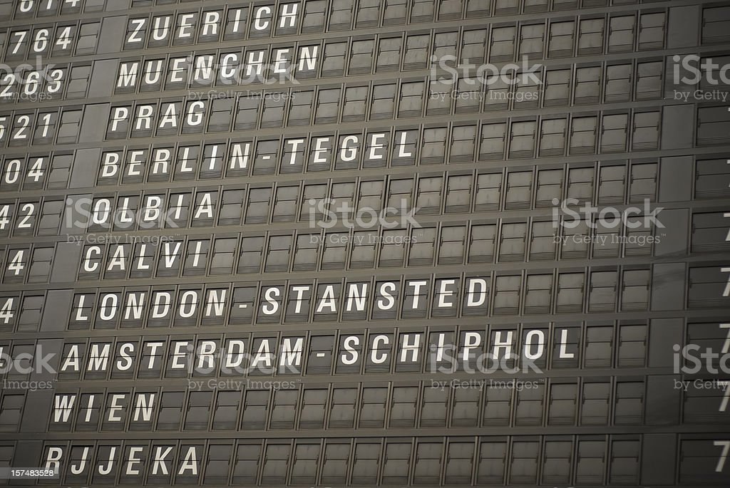 Destinations board at airport, arrivals and departures royalty-free stock photo