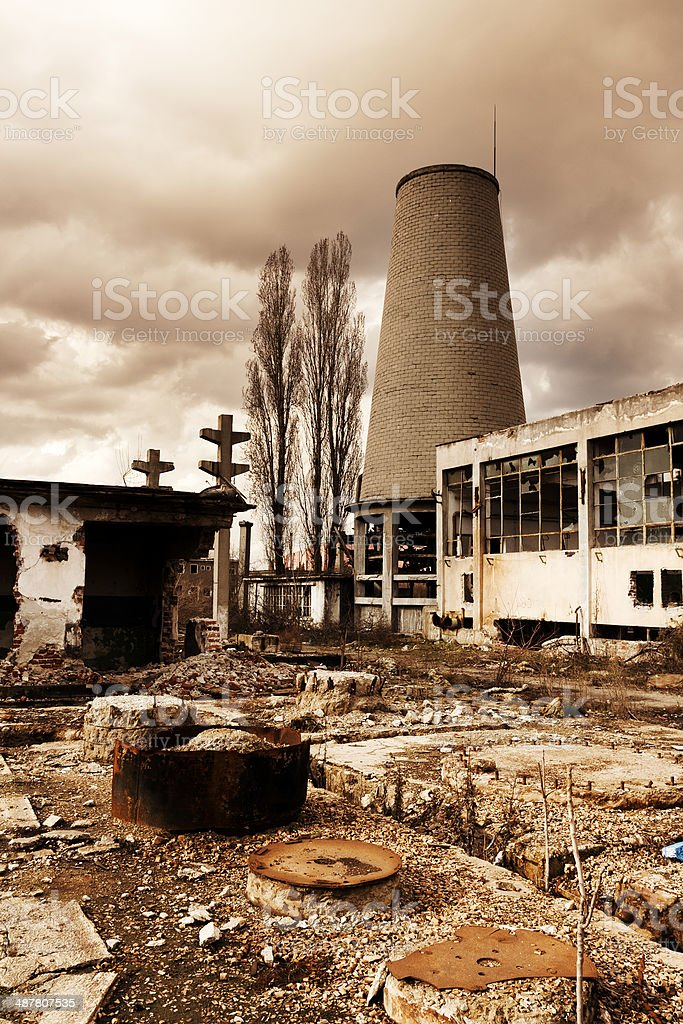 Destroyed, abandoned industrial building and courtyard on crisis time. Toned. royalty-free stock photo