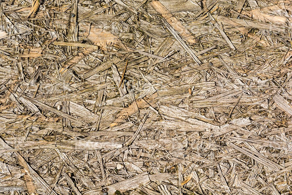 Destroyed board (OSB) as a texture. stock photo