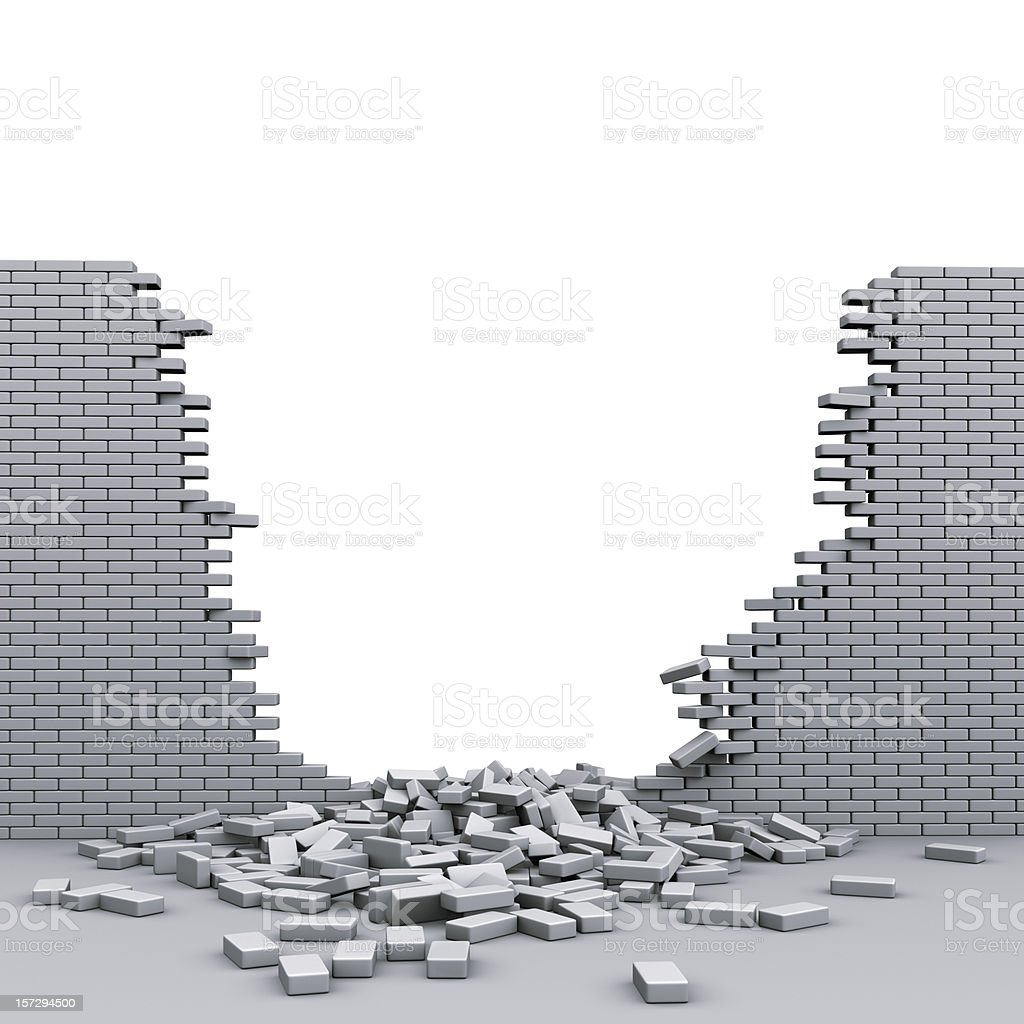 A destroyed brickwall with broken bricks stock photo