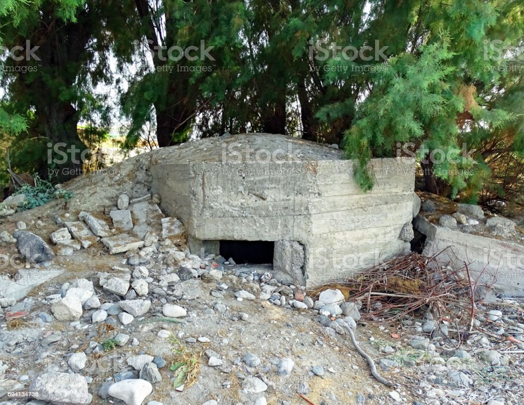 Destroyed bunker on the beach of Psalidi on the Mediterranean island of Kos in Greece stock photo