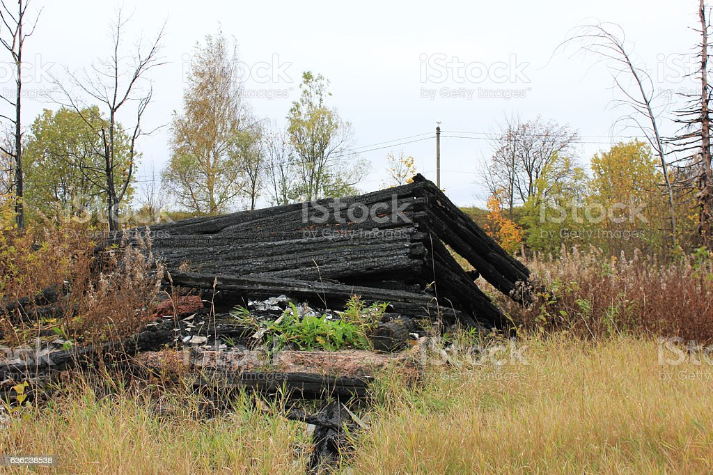 Destroyed burned out abandoned old house foundation ruins stock photo