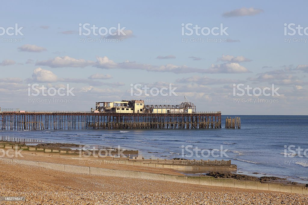 Destroyed by arsonists, the fire damaged pier at Hastings, UK stock photo
