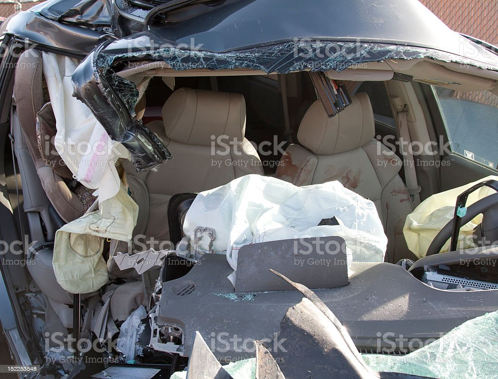 A destroyed car from the front that after a fatal car crash stock photo