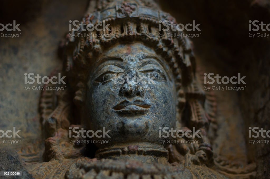 Destroyed face of Deity sculpture under eves on shrine outer wall in the Chennakesava temple at Somanathapura,Karnataka,India stock photo