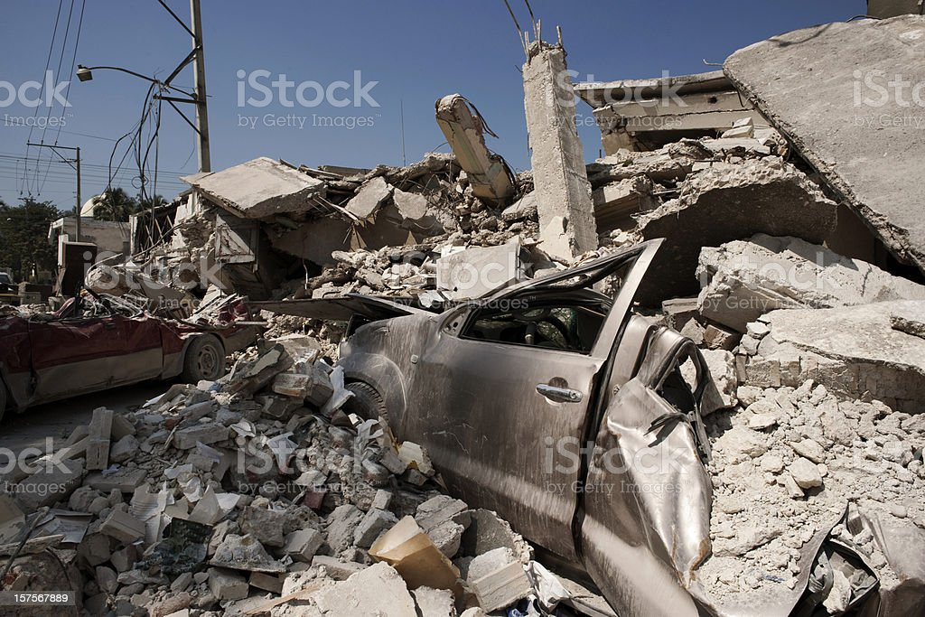 Destroyed houses and cars after earthquake stock photo