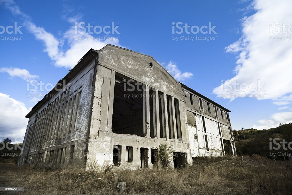 Destroyed industrial building. Crisis time. Perfect Sky. royalty-free stock photo