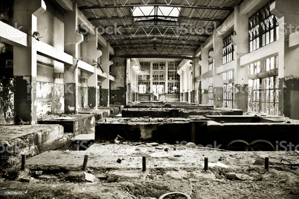 Destroyed interior of an industrial building royalty-free stock photo