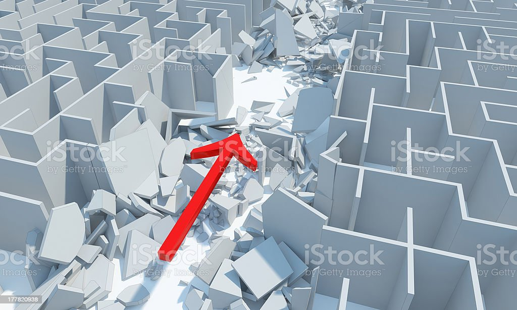 Destroyed maze with arrow pointing through royalty-free stock photo