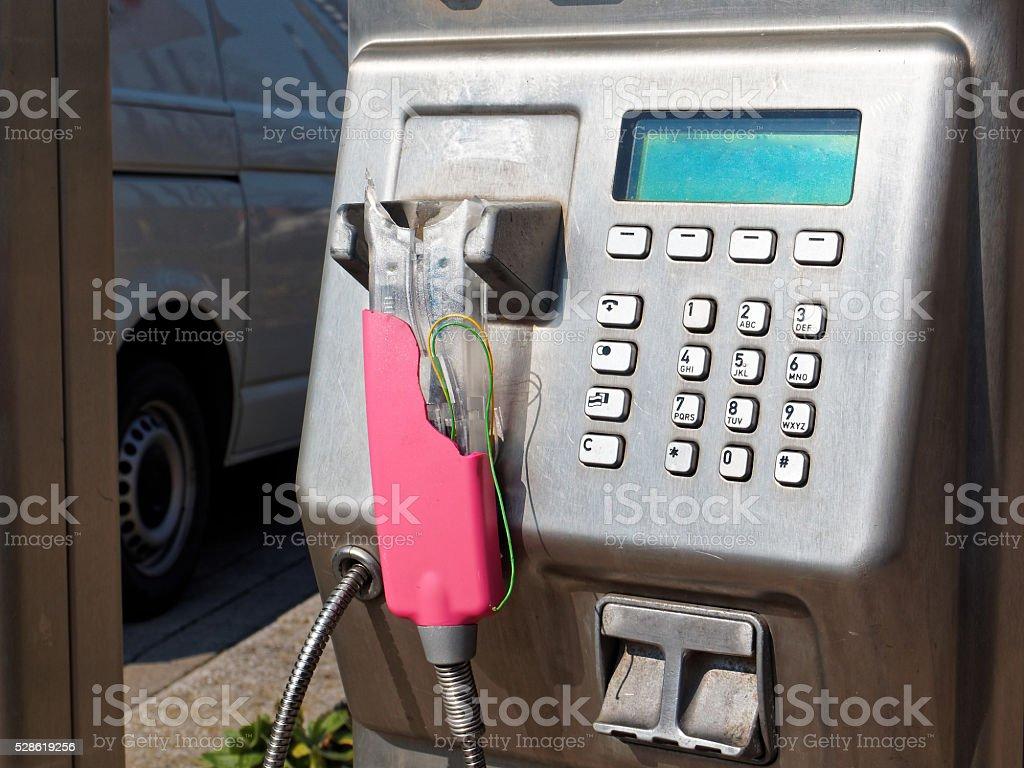 destroyed public phone box - communication breakdown stock photo