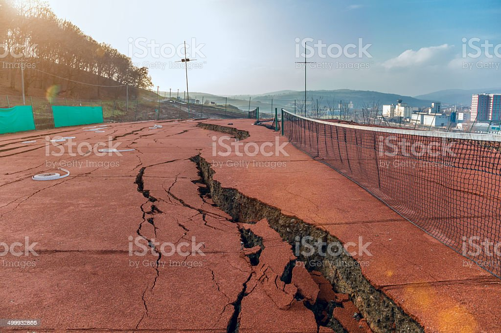 Destroyed tennis field stock photo