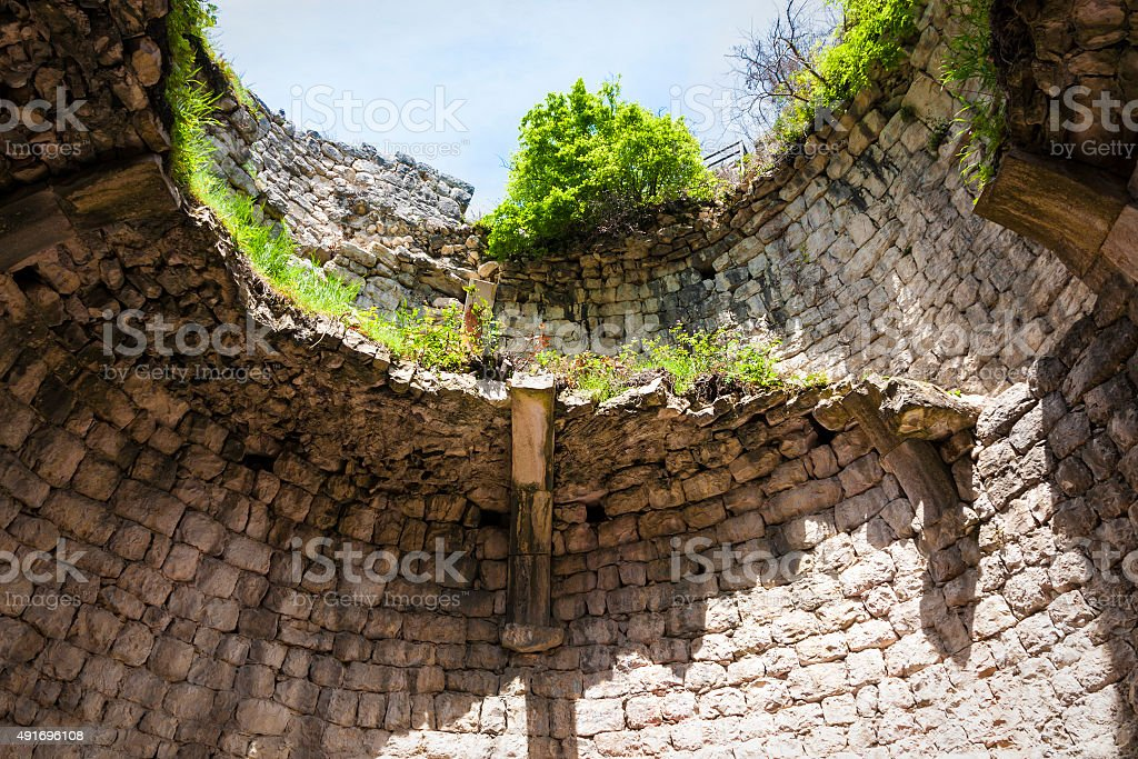 destroyed wall in Anakopia stronghold on the Iberian mountain stock photo