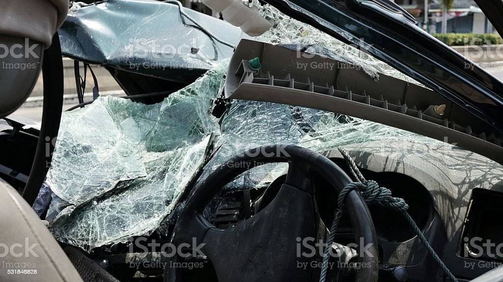 Destroyed windshield and damaged front part of limousine car stock photo
