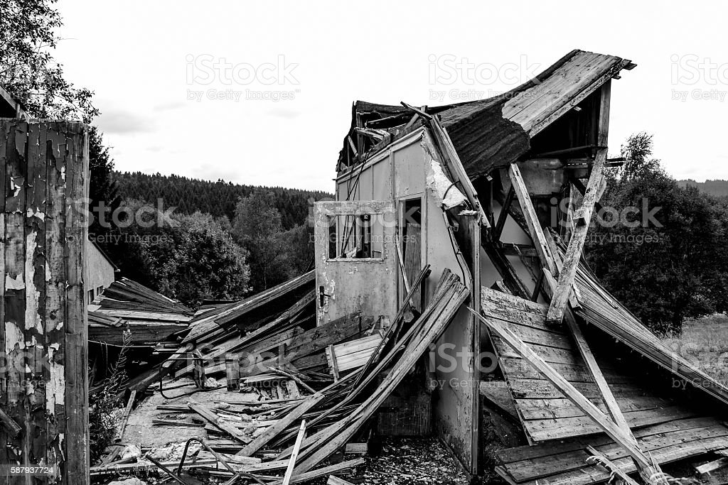 destroyed wooden house in the countryside stock photo