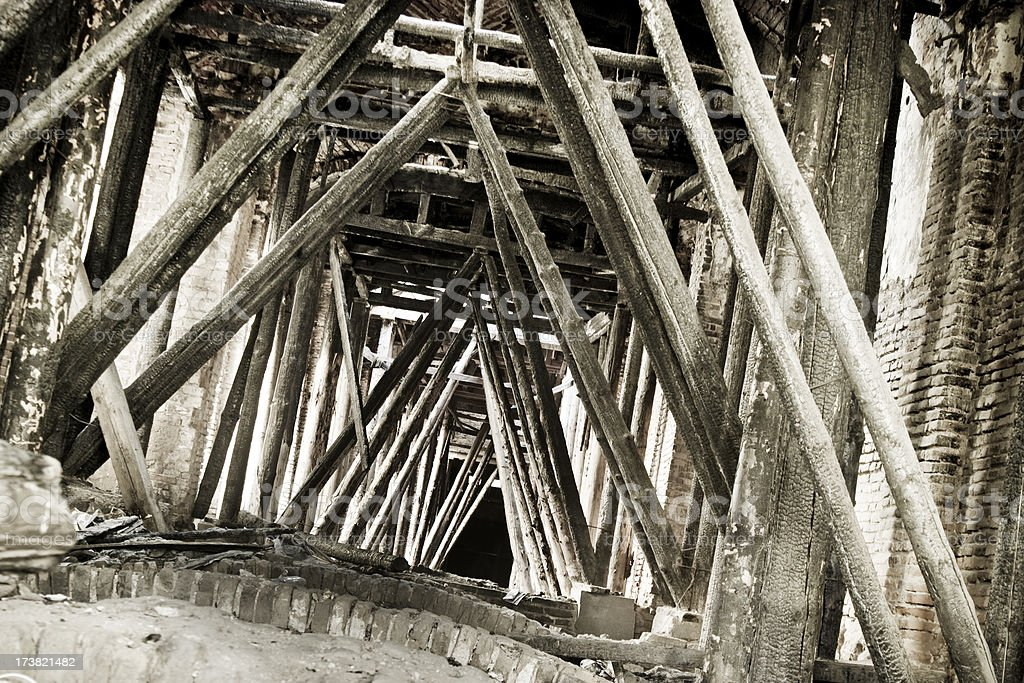 Destroyed wooden structure of a very old  building royalty-free stock photo