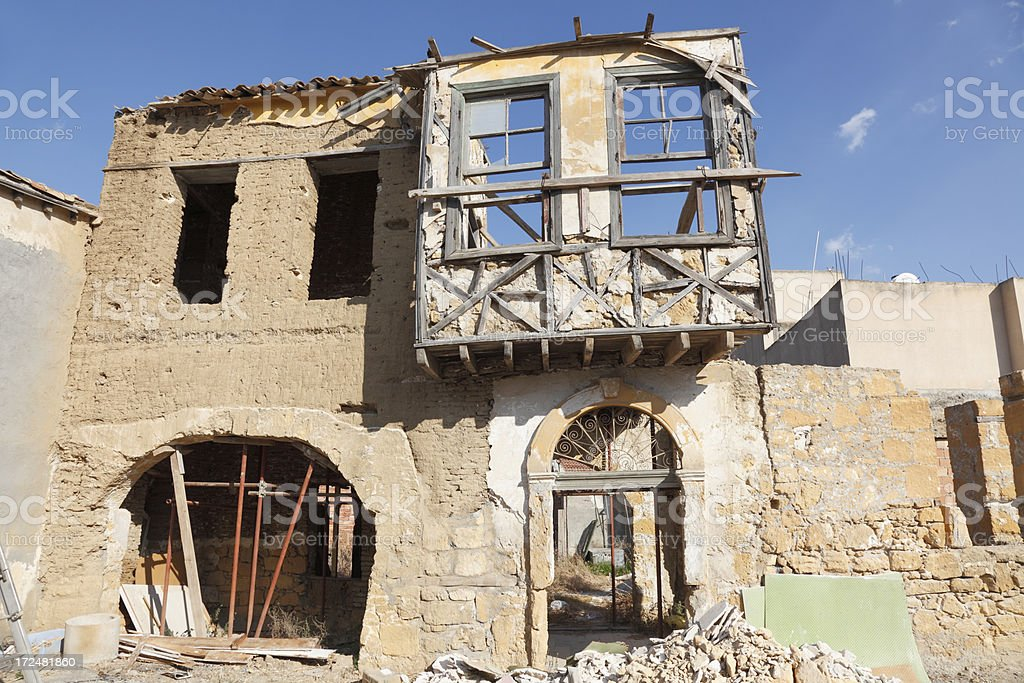 destroyed worn out house facade against blue sky Nicosia Cyprus stock photo