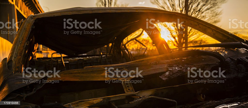 Destroyed,burned and rusty, car under the Kosciuszko bridge stock photo