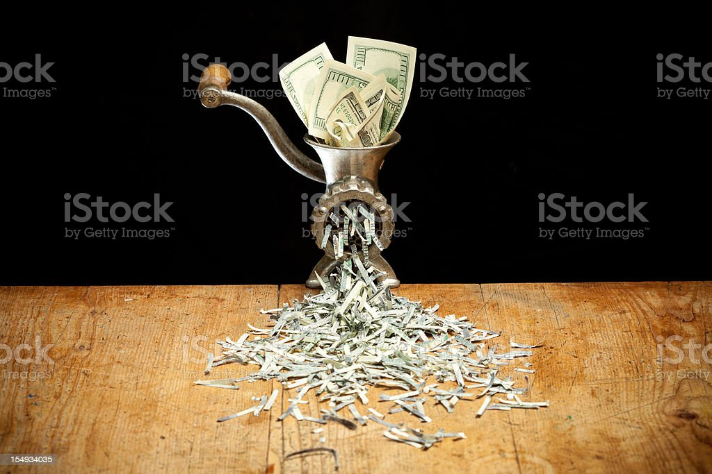Destroying Dollars with a grinder stock photo