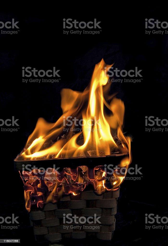 Destroying Evidence basket burning stock photo