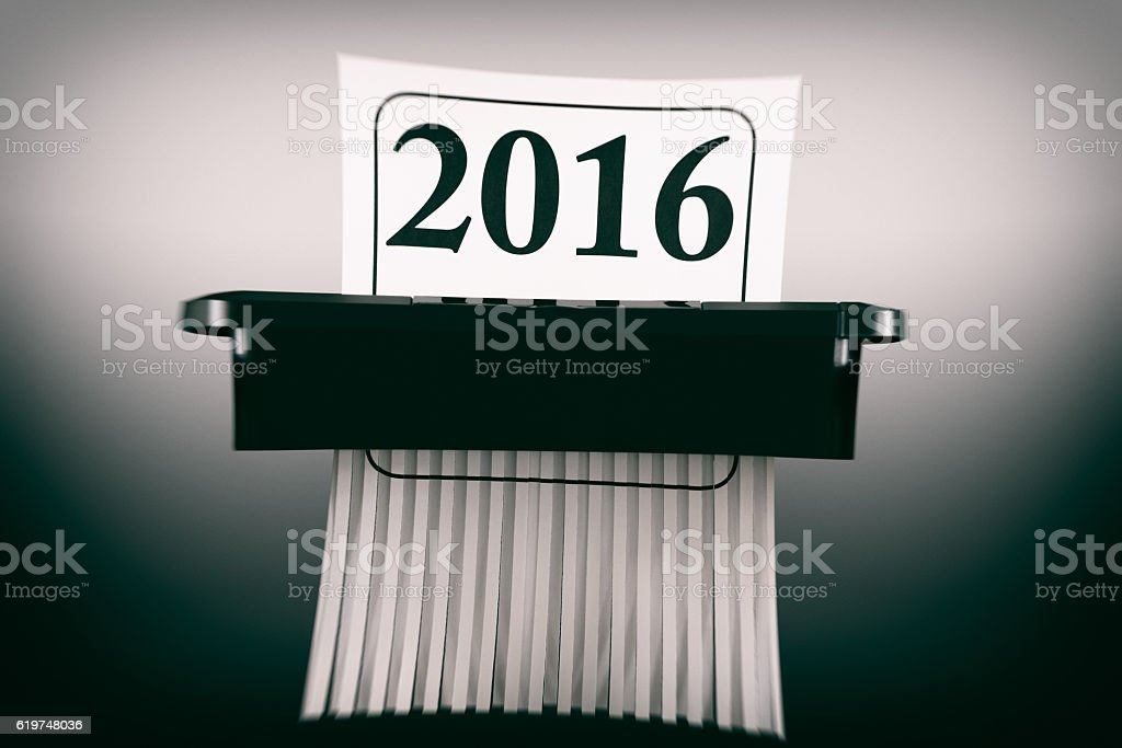 Destroying the Year 2016 in a Paper Shredder stock photo