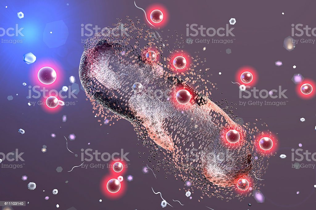 Destruction of a bacterium by silver nanoparticles stock photo