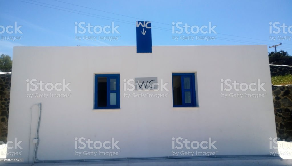 Detached building toilet in white-blue colors on the island of Santorini in Greece stock photo