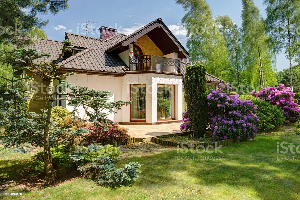 Detached house and beauty garden stock photo