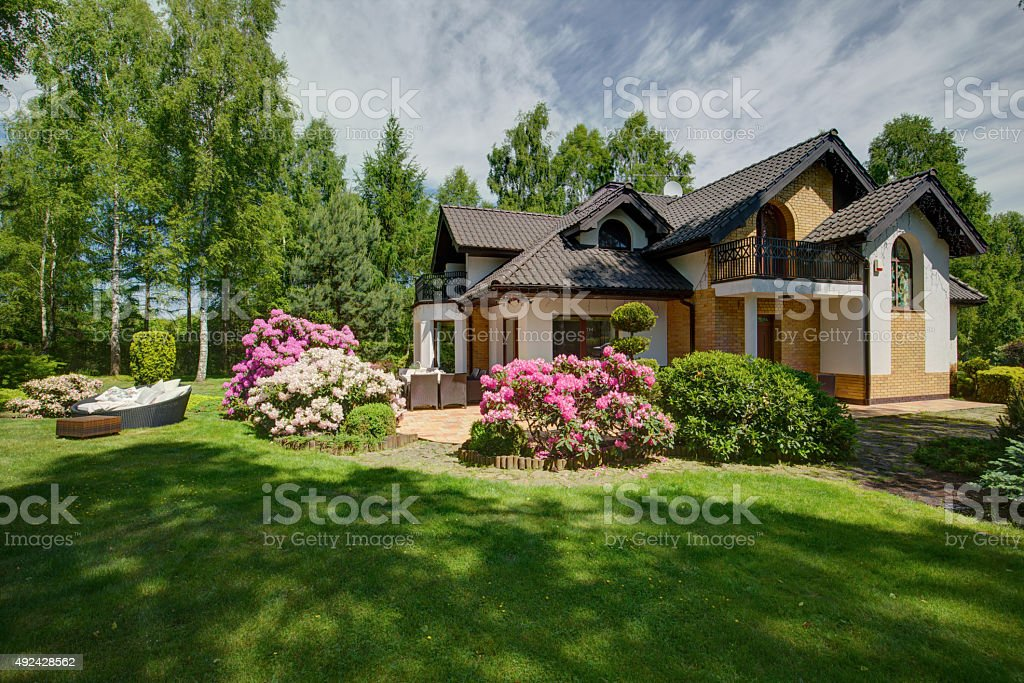 Detached house with beauty garden stock photo