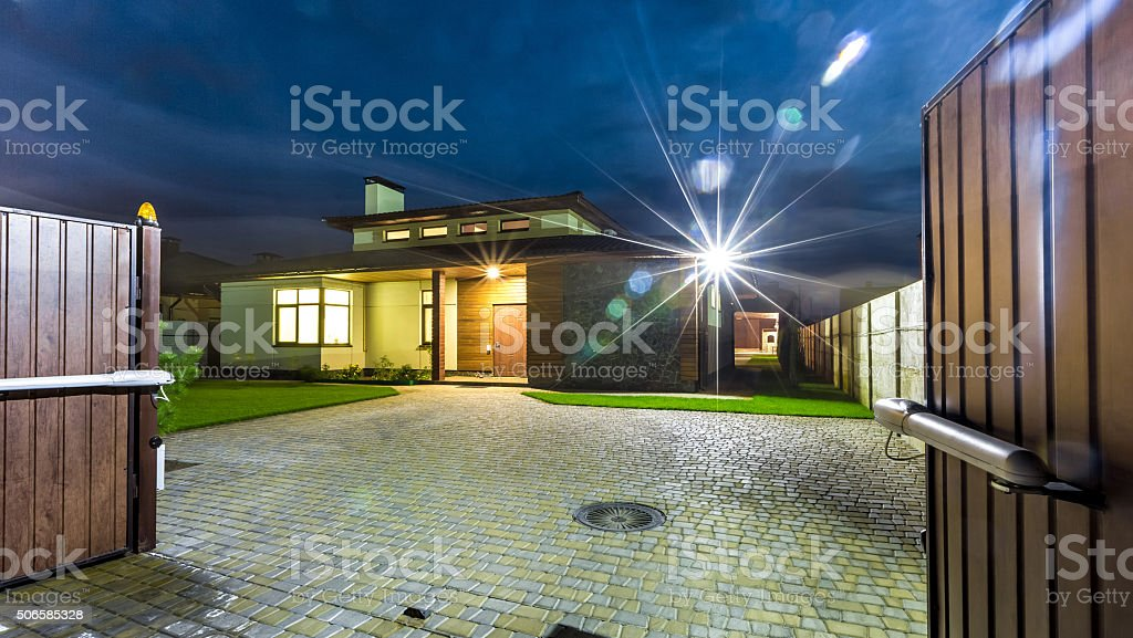 Detached luxury house at night - view from outside. stock photo