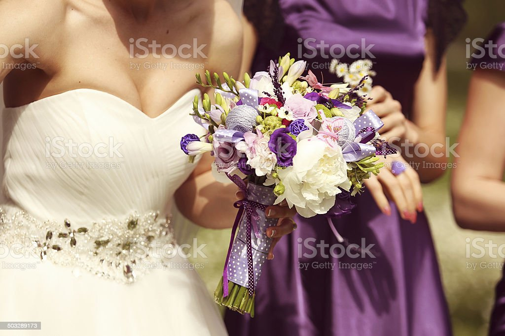 Detail and bride and bridesmaid with flowers stock photo