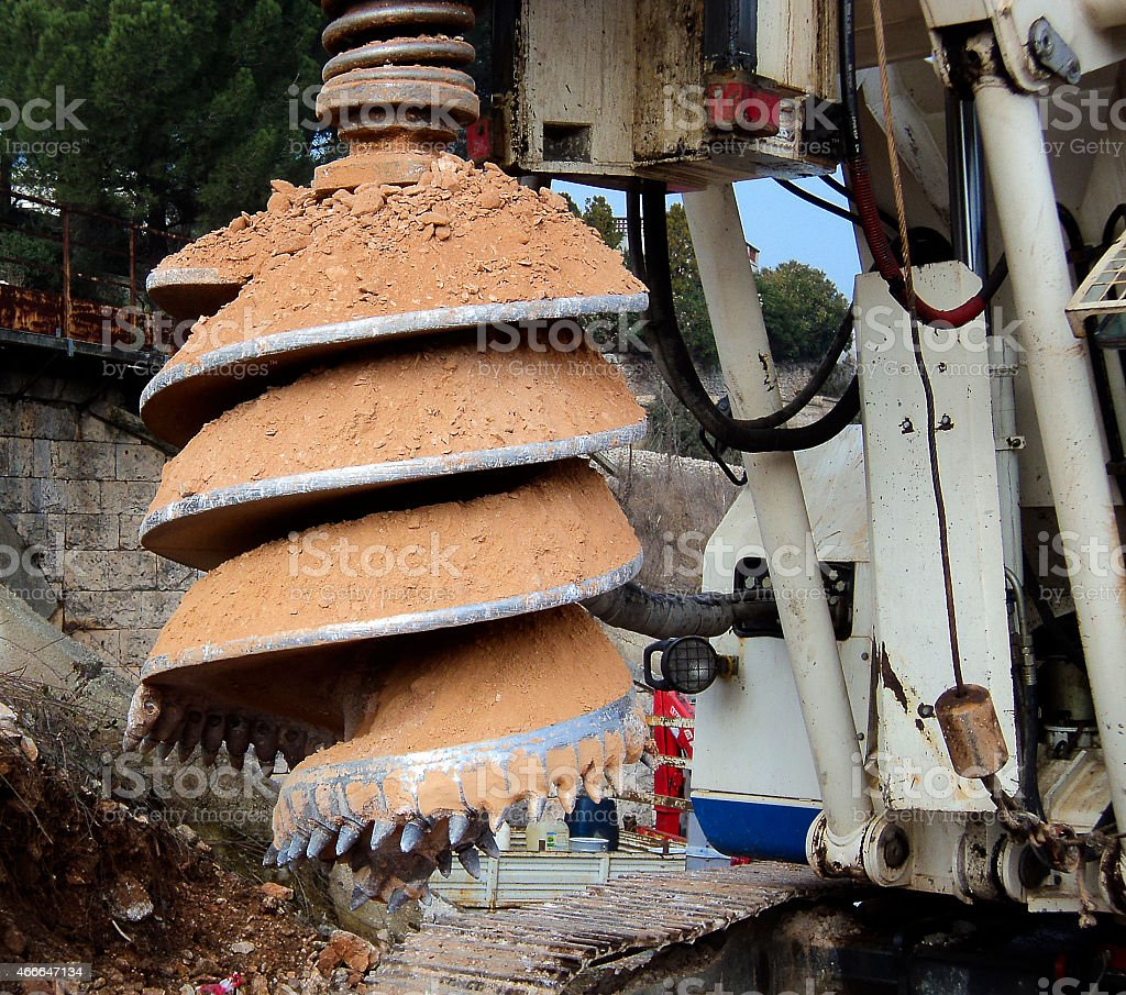 detail drilling machine boring holes in ground stock photo