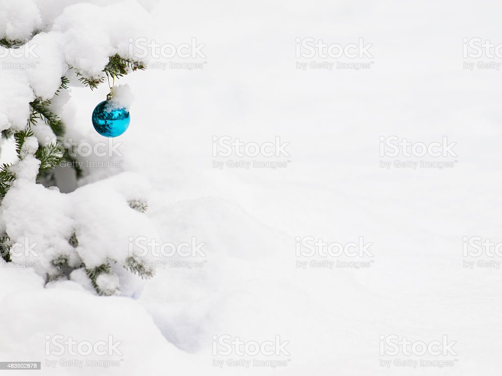 Detail from Christmast ball with snow stock photo