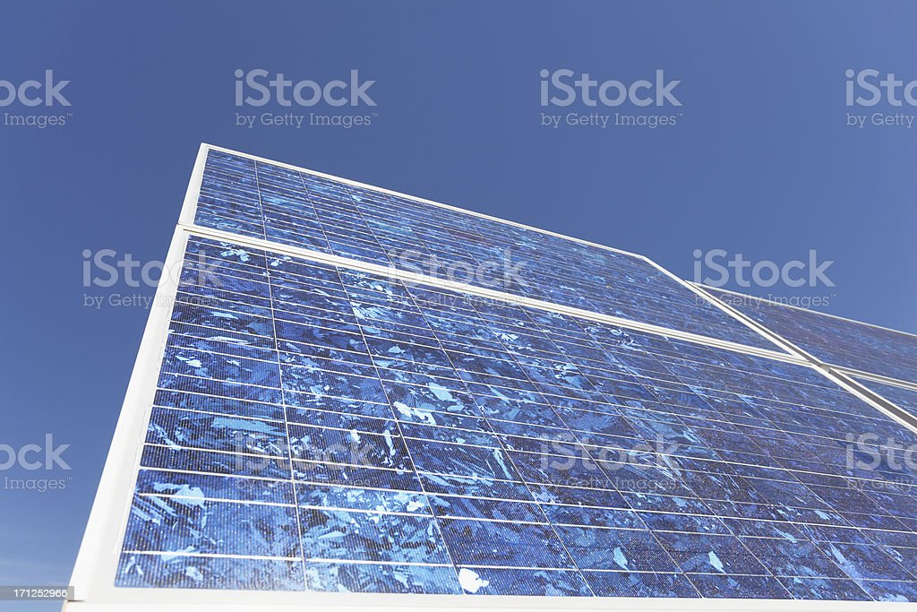detail  front view of solar panel against perfect blue sky royalty-free stock photo