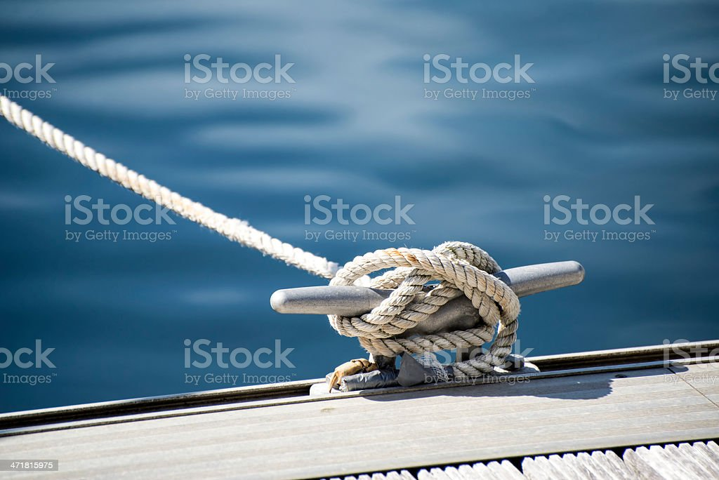 Detail image of yacht rope cleat on sailboat deck stock photo