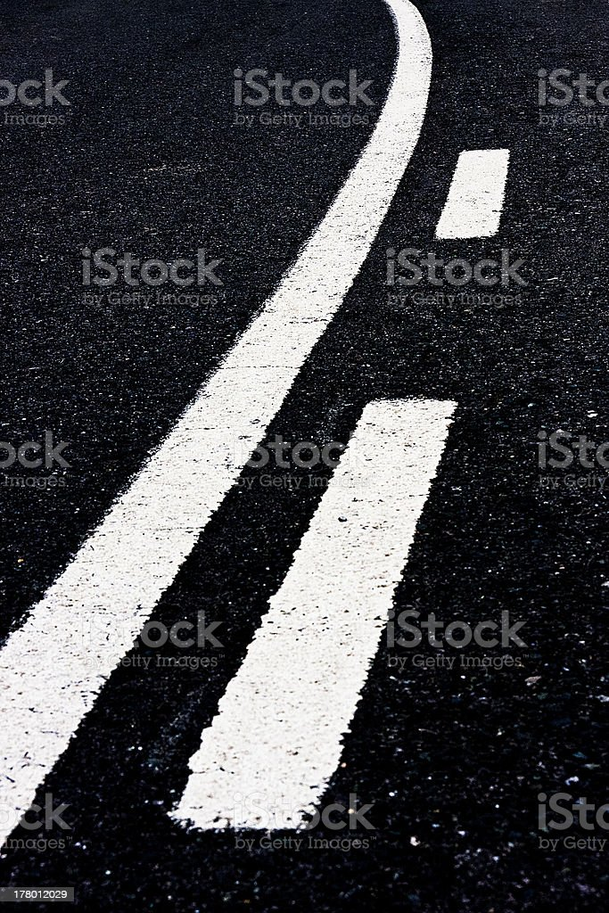 Detail markings of a road along curve. stock photo