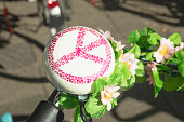 Detail of a bicycle's ring bell with sign of 'Peace'