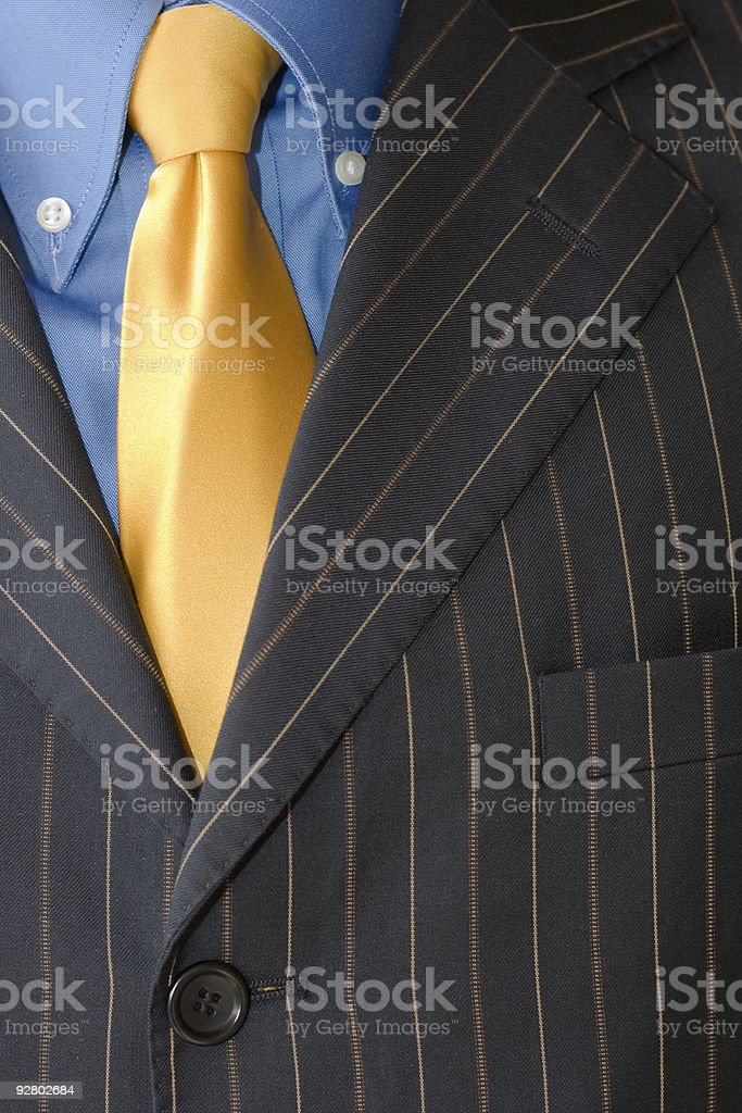 Detail of a Business man Suit with blue yellow royalty-free stock photo