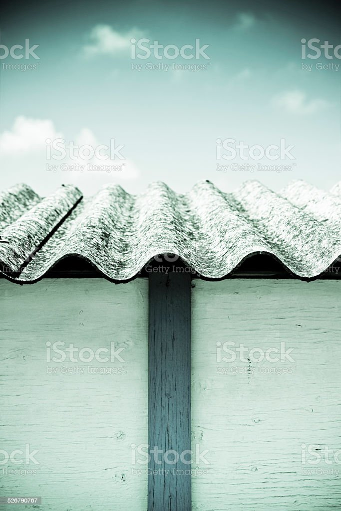 Detail of a dangerous asbestos roof stock photo