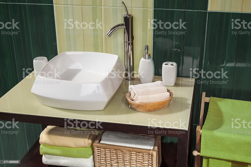 detail of a green modern bathroom with sink stock photo