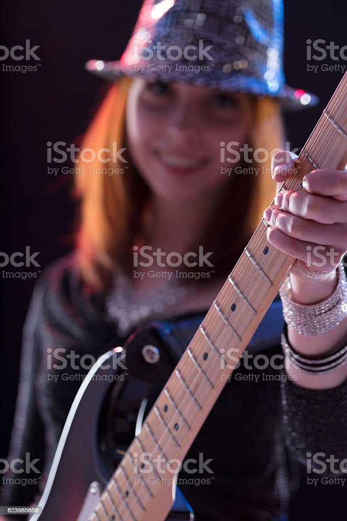 detail of a guitar grip by guitar player stock photo