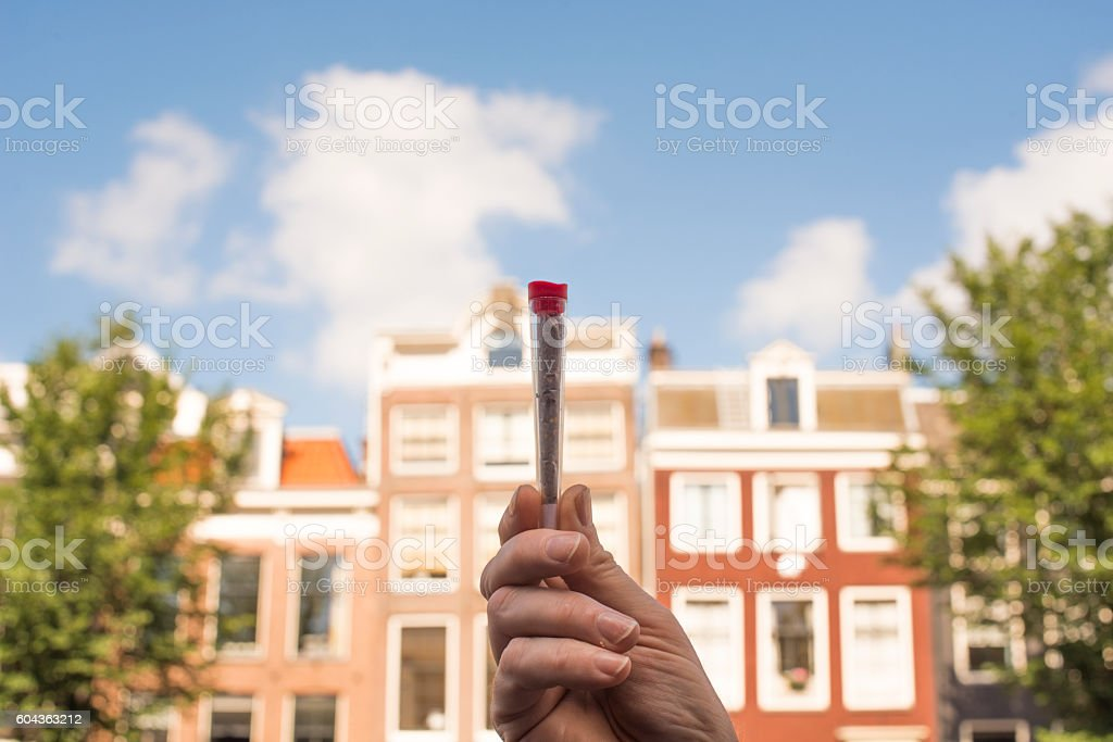 Detail of a man holding a joint stock photo