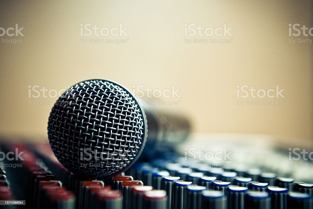 detail of a mic over dj audio console stock photo