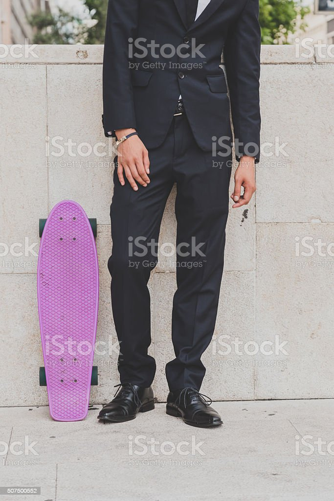 Detail of a model posing with his skateboard stock photo