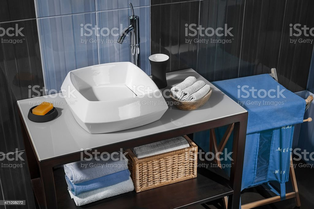 detail of a modern bathroom with sink and accessories_03 stock photo